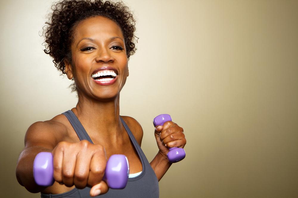 african american woman using barbells