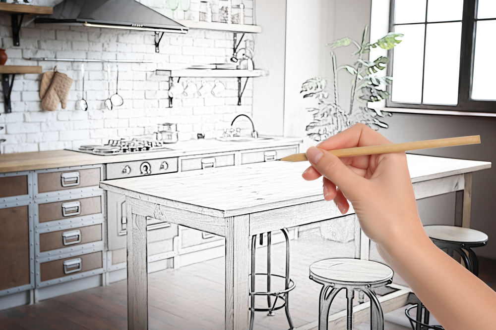 kitchen being designed by a hand with pencil