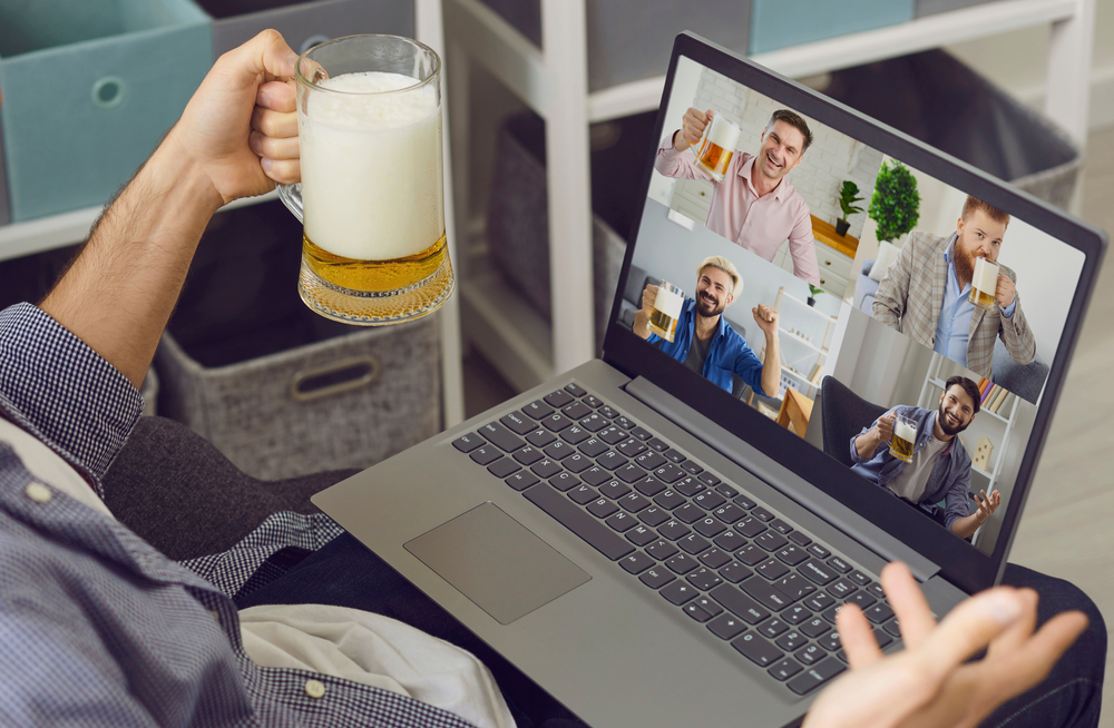 group of men sharing a virtual drink over a meeting app