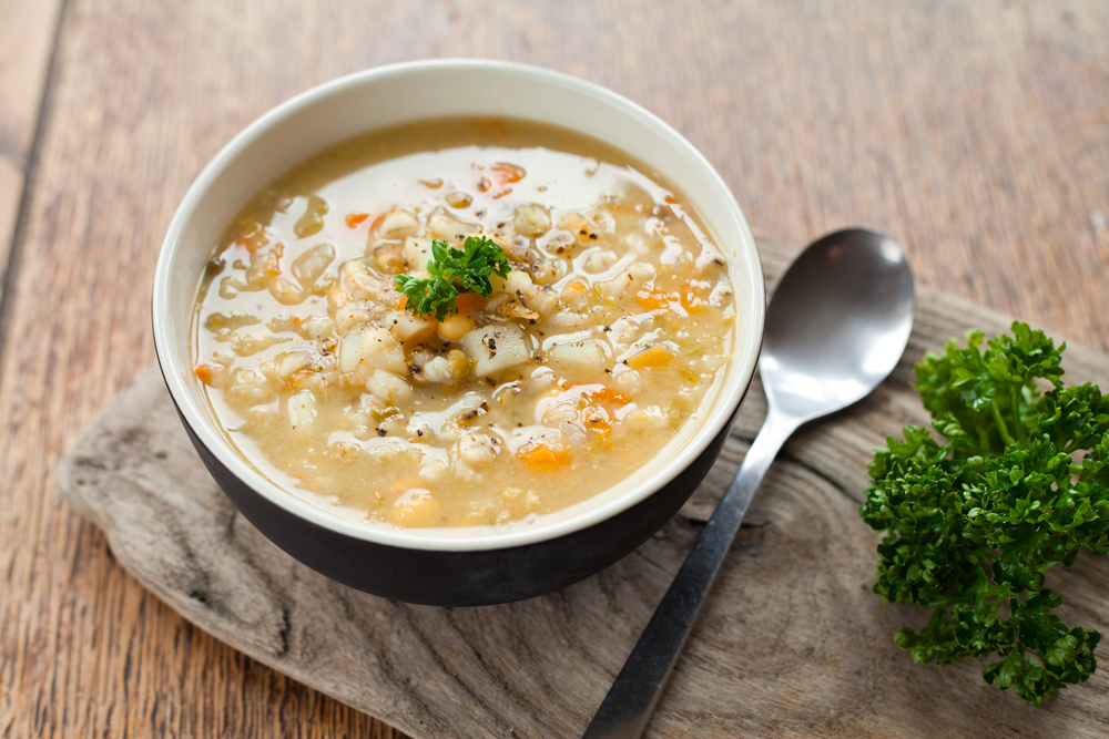 barley soup on wooden serving tray