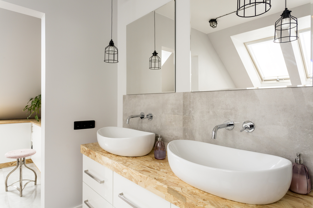 minimalist white bathroom with two sinks