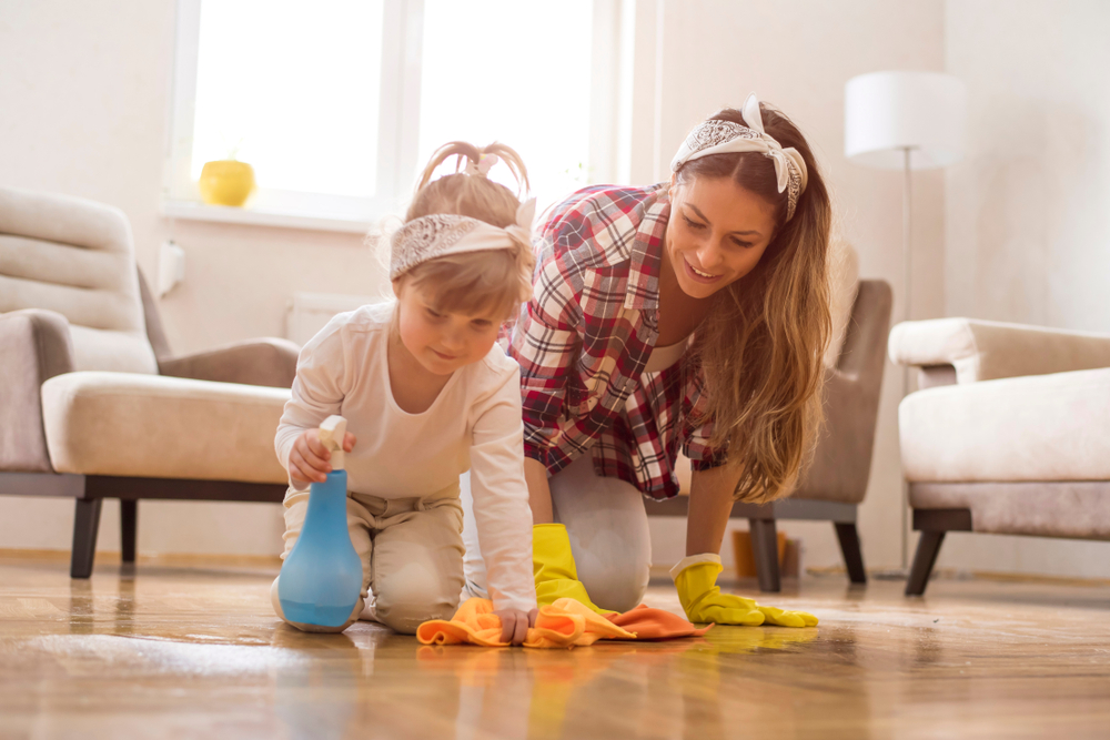 mom and little girl cleaning the floor