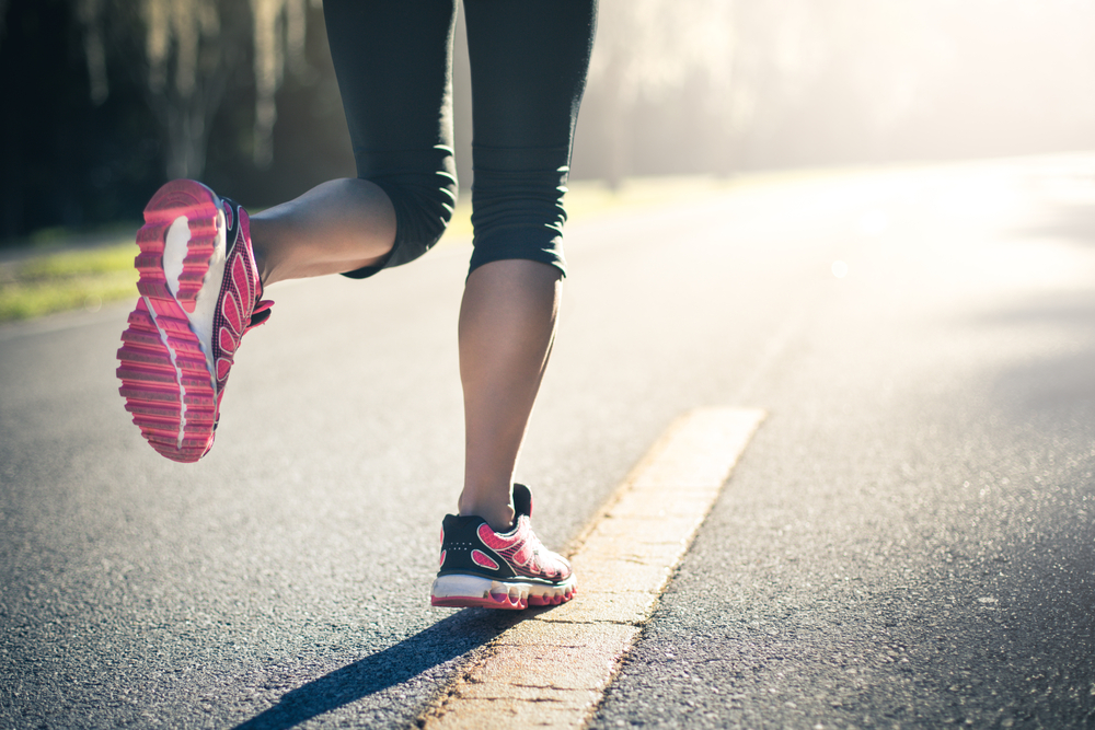 woman running in workout shoes