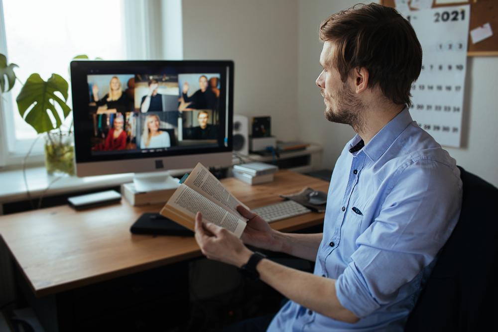 man attends virtual book club