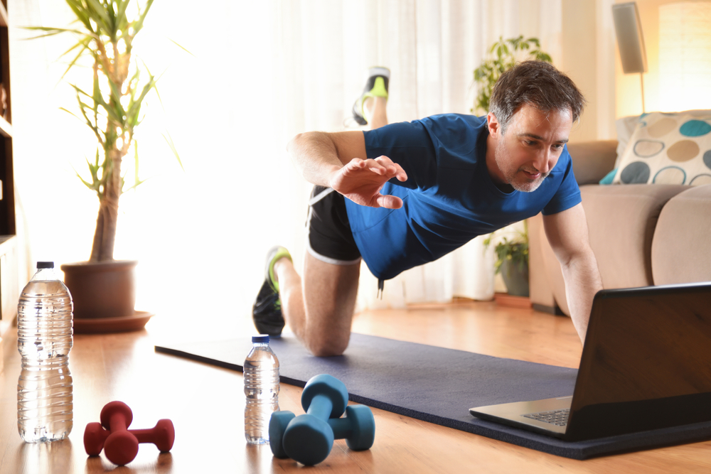 middle-aged man virtually working out at home