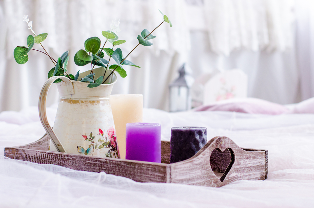 pastel palette on a serving tray with purple candle and spring time vase