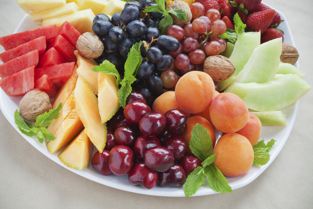 colorful fruit platter with walnuts