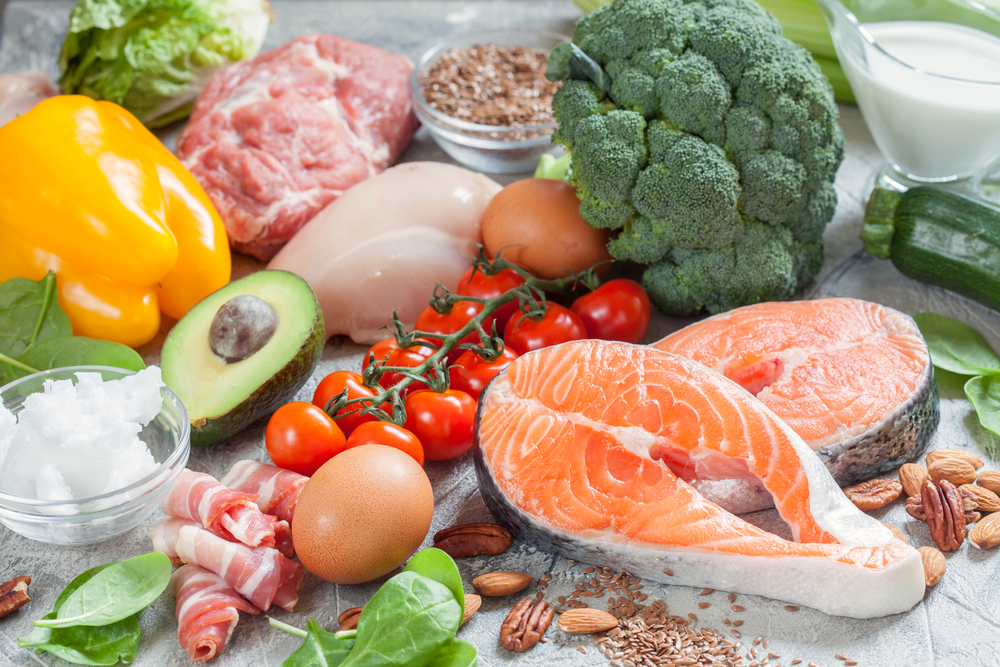 keto diet foods including salmon, avocados, broccoli, and other vegetables